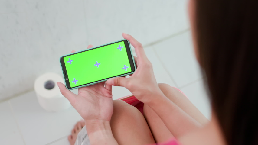 Woman use smart phone with green screen in wc | Shutterstock HD Video #1037462192