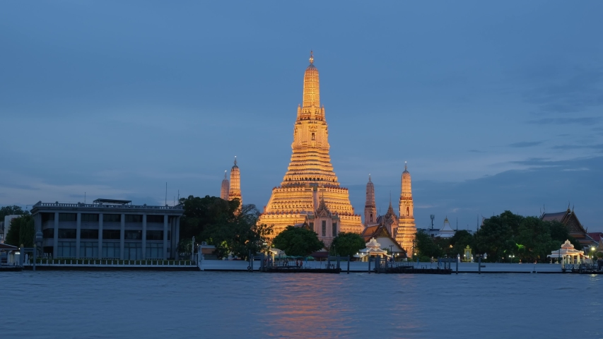 4K Time lapse, Wat arun, Boat traffic in the Chao Phraya River and in the city center, Bangkok city view of chao phraya river major river in Thailand. | Shutterstock HD Video #1037507192