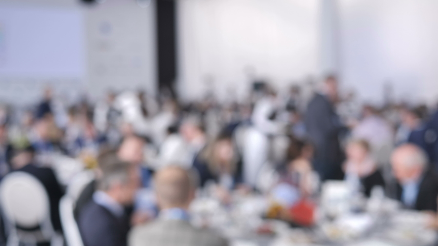 Blurred Background Catering Service Waiter Put Plates with Dishes on the Guests Table at a Wedding or Conference.   Shutterstock HD Video #1037723612
