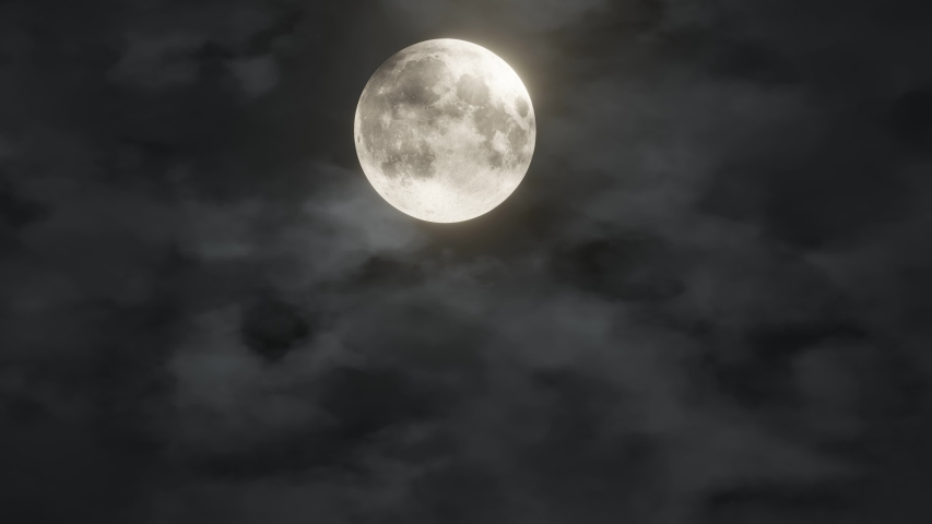 Full glowing yellow moon with clouds being blown by winds during storm at nights. Element of this footage furnished by NASA #1037728922