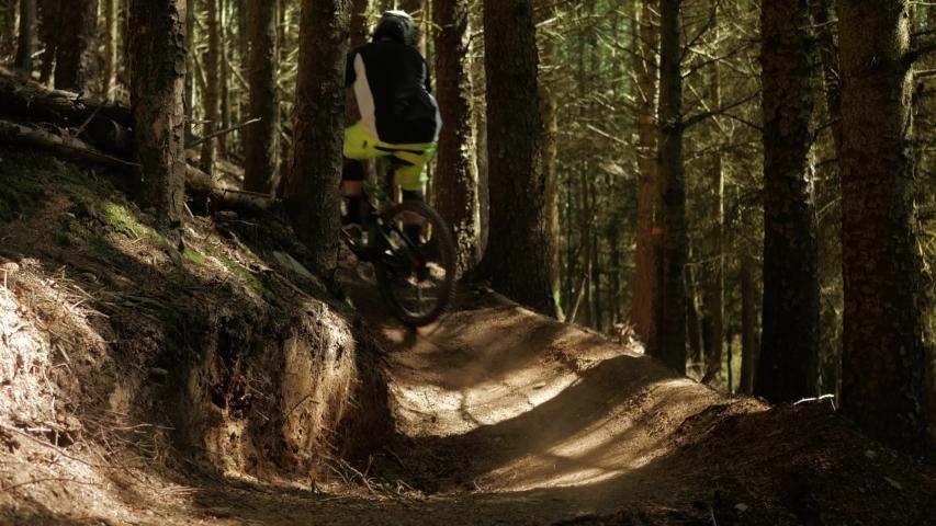 Barnstaple / United Kingdom (UK) - 05 20 2019: Mountain Biking Mtb Cyclist man Cycling On Bike down through the forest. UK