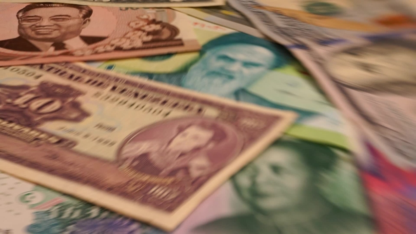 Optically distorted and blurry images of a set of banknotes of world currencies. Dollars, yuan, rials, won, rubles, euros. | Shutterstock HD Video #1038349022