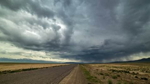 Almaty, Kazakhstan - 15 may 2015: Thunderstorm storm in the desert along the road. 4K TimeLapse.