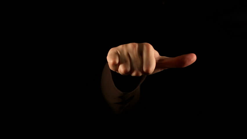 Thumb down gesture on black background | Shutterstock HD Video #1038592
