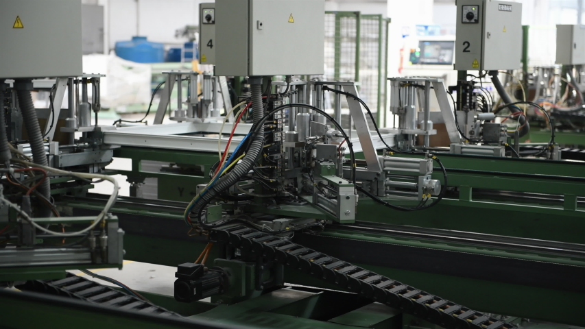 Automatic conveyor machine on making windows in the factory. | Shutterstock HD Video #1038721232