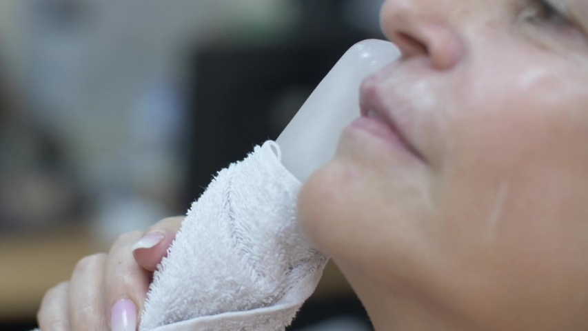 Cosmetic clinic, woman getting a Hyaluronic acid injection it is used to reduce the appearance of fine lines and wrinkles, facial folds, and to create structure, framework and volume of the lips | Shutterstock HD Video #1038761702