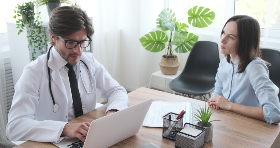 Doctor and patient talking at medical clinic | Shutterstock HD Video #1038813542