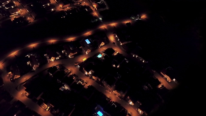 Aerial view of power outage blackout in suburban neighborhood. | Shutterstock HD Video #1038851882