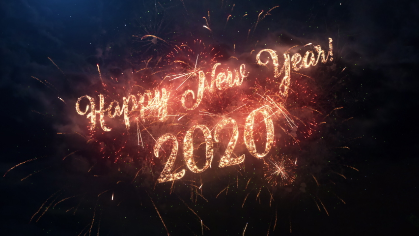 2020 Happy New Year greeting text with particles and sparks on black night sky with colored slow motion fireworks on background, beautiful typography magic design.