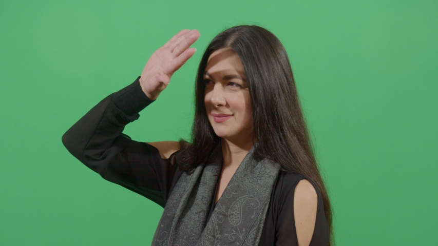 Woman Using The Hand As A Shade. Studio Isolated Shot Against Green Screen Background | Shutterstock HD Video #1039150982