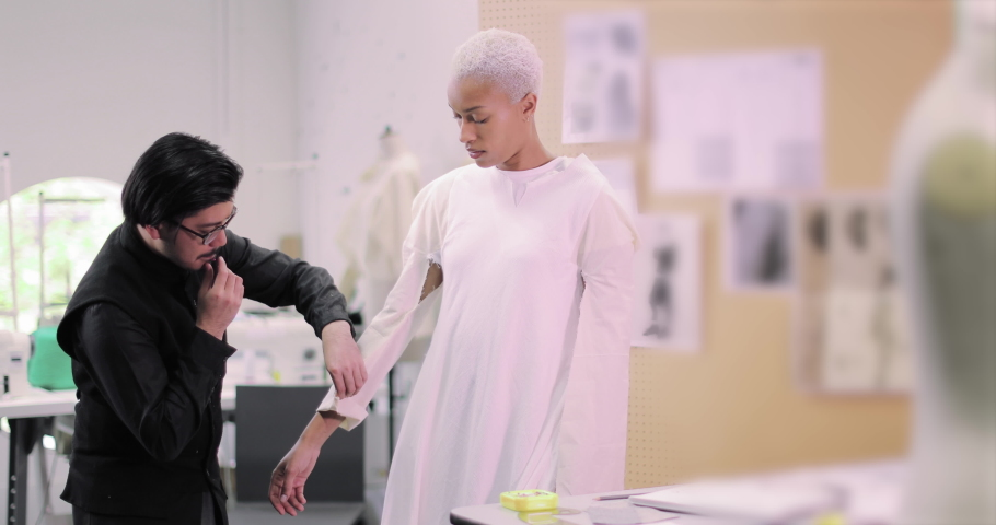 Fashion designer working on design with a model | Shutterstock HD Video #1039185992