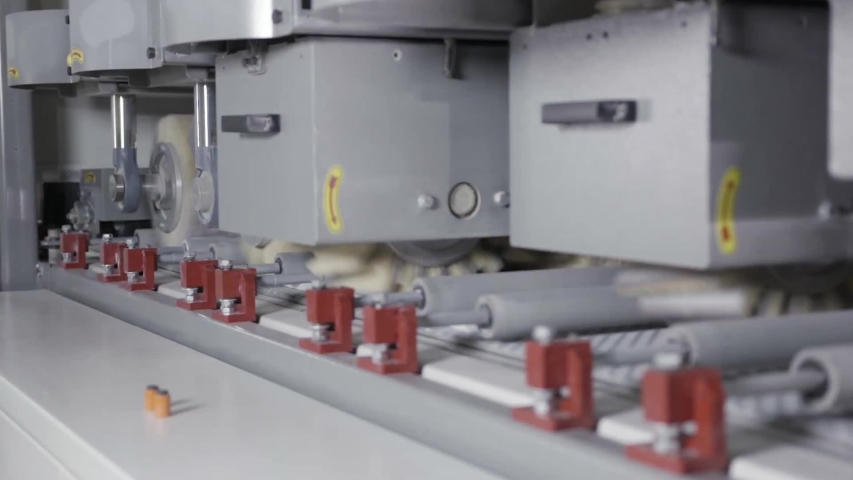 Close up of metal polishing machine during working process, equipment and technologies concept. Action. Machine with many rotating brushes cleaning and polishing metal sheet. | Shutterstock HD Video #1039214042