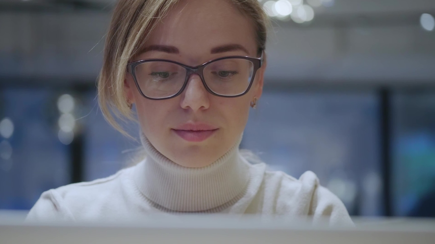 Closeup portrait of a girl with glasses working on a laptop | Shutterstock HD Video #1039226312