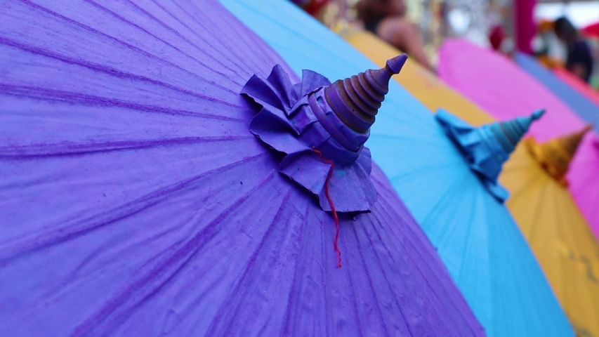 Umbrellas made of colorful fabrics, Thai crafts Lanna umbrella,Chiang Mai Thailand. | Shutterstock HD Video #1039281332