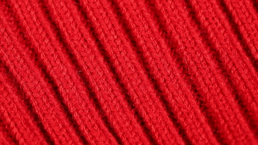 Part of the red woolen cloth rotates slowly. background   Shutterstock HD Video #1039437632