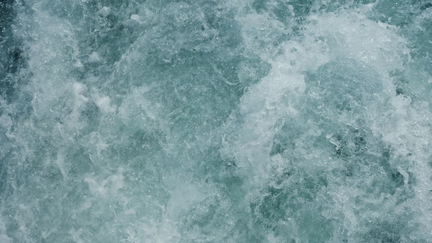 speed tourist motorboat sails in emerald sea making white foamy trace waves slow motion close view #1039526852
