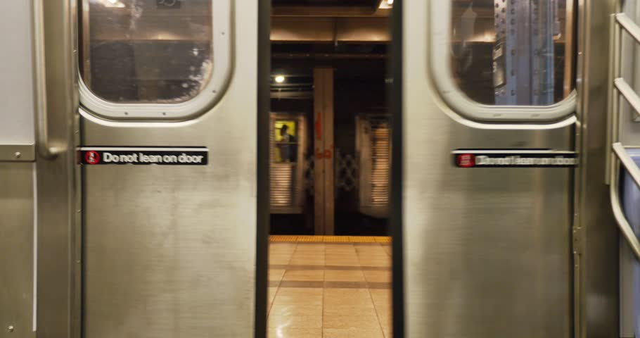 NEW YORK - CIRCA 2015 A subway passenger exits the car. | Shutterstock HD Video #10395572