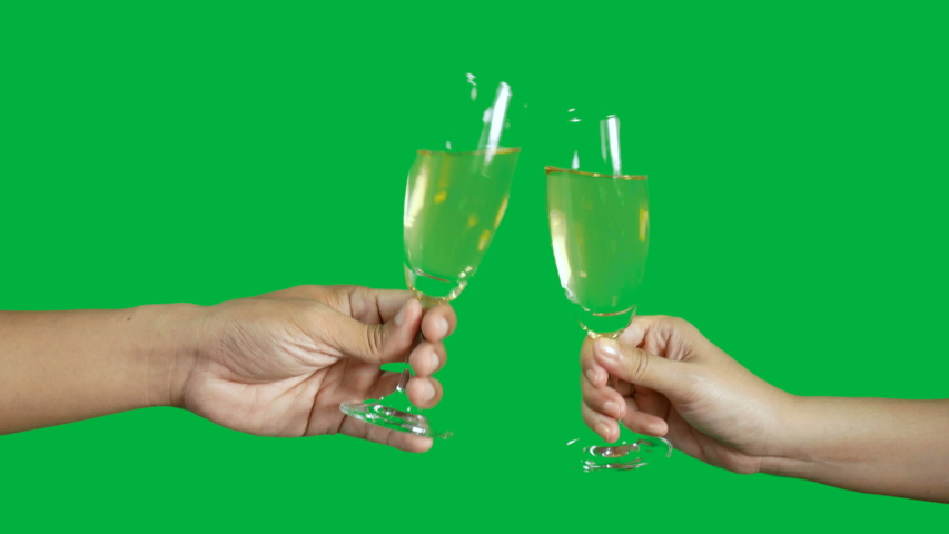 4K. two people clinking each other's with glass of champagne isolated on chroma key green screen background | Shutterstock HD Video #1039570442