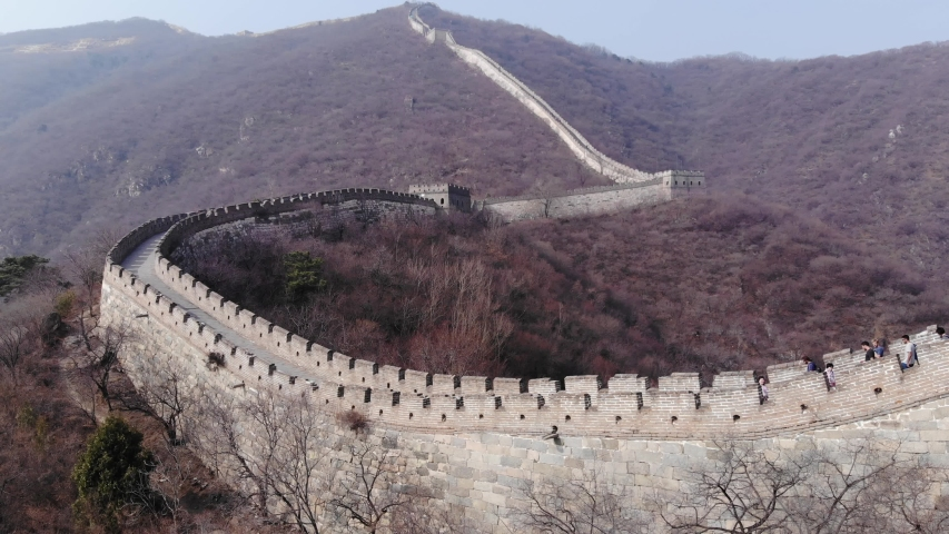 BEIJING - MARCH 26, 2018: Great Wall of China, stone fortification follow mountainous terrain, running up by hill slope. Famous landmark and popular tourist attraction, restored Mutianyu section | Shutterstock HD Video #1039592702