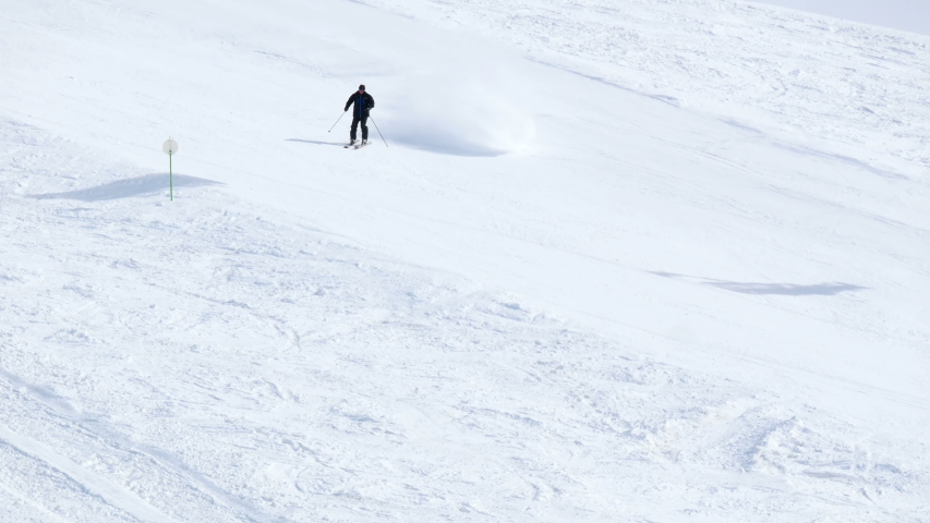 Extreme freeride snowboarder ski snow in remote mountain high in the sunny mountains