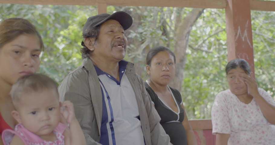 Puerto Rico, Pando, Bolivia - April 8 2017: Man with Cap, Surrounded by Women, Young Woman with Dark Hair with a Baby in her Arms, in the Amazon Forest | Shutterstock HD Video #1040005082