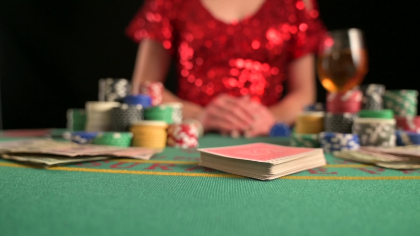 Girl, woman plays in casino, poker. Game room, chips, victory over games. | Shutterstock HD Video #1040136932