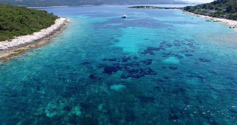 Dalmatian coast. Croatia. Virgin Bay with catamaran, boat.