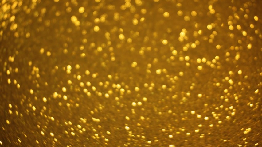 Rotating sparkling golden glitter bokeh. Seamlessly looping background. #1040238932