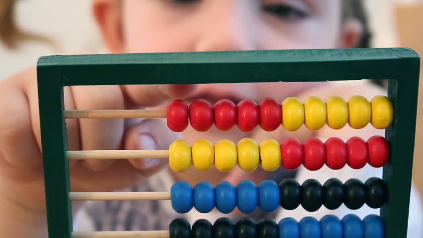 little girl counts on abacus