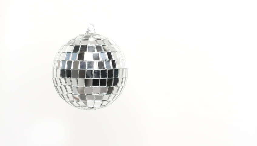 Disco Mirror Ball Spinning on white background | Shutterstock HD Video #1040289572