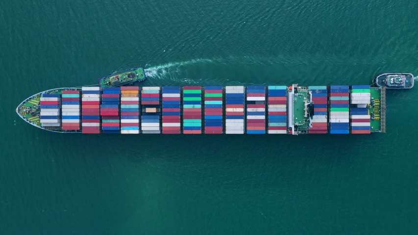 Aerial view of sea freight, Cargo ship, Cargo container in factory harbor at industrial estate for import export around in the world, Trade Port / Shipping - cargo to harbor | Shutterstock HD Video #1040515352