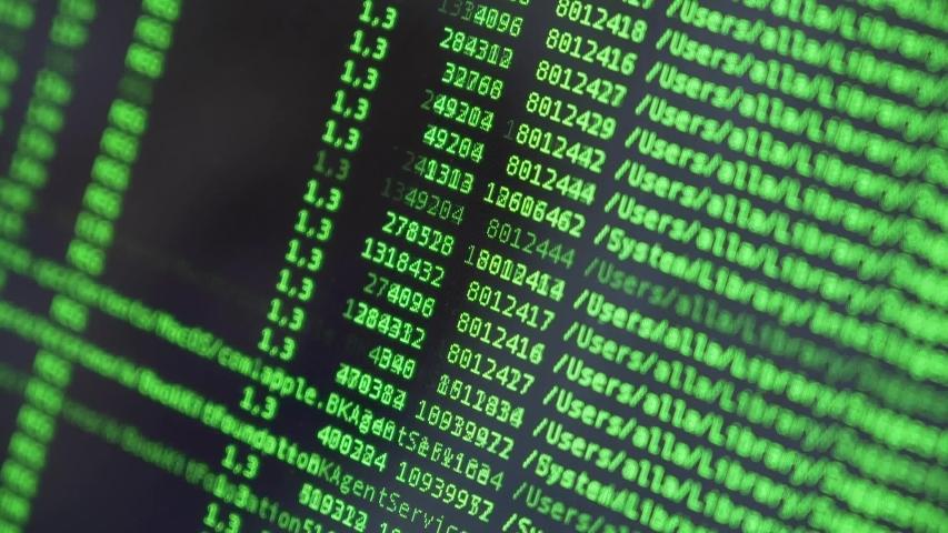 Hexadecimal code running up a computer screen. Green-ish digits. Close-up shot. Shallow depth of field. | Shutterstock HD Video #1040618492