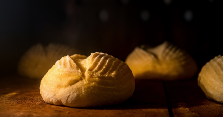 Warm fresh ciabatta in a bakery. Making bread and eco production. Manufacturing process working hard. Bakery shop and selling rooty. Baking Italian bio bread in oven. Time lapse footage of cooking. | Shutterstock HD Video #1040714132