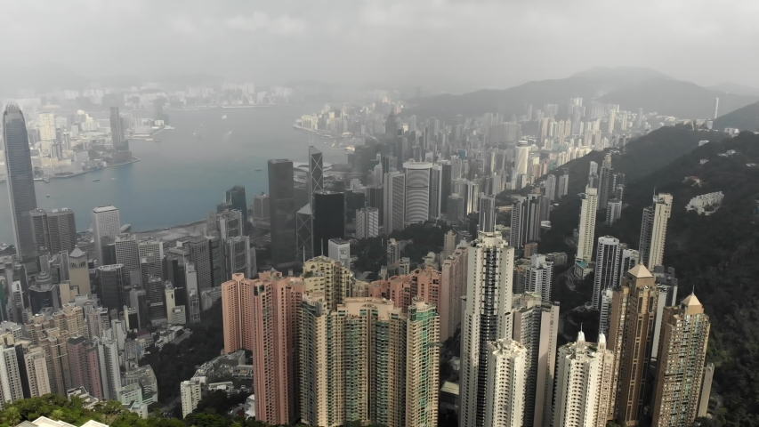 Aerial view from Victoria Peak in Hong Kong. Residential buildings, business centers, Victoria Bay.   Shutterstock HD Video #1040818952