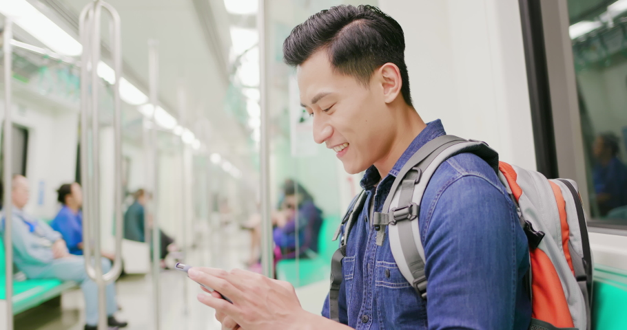 Asian young man use 5g smartphone on the mrt or train | Shutterstock HD Video #1040827262