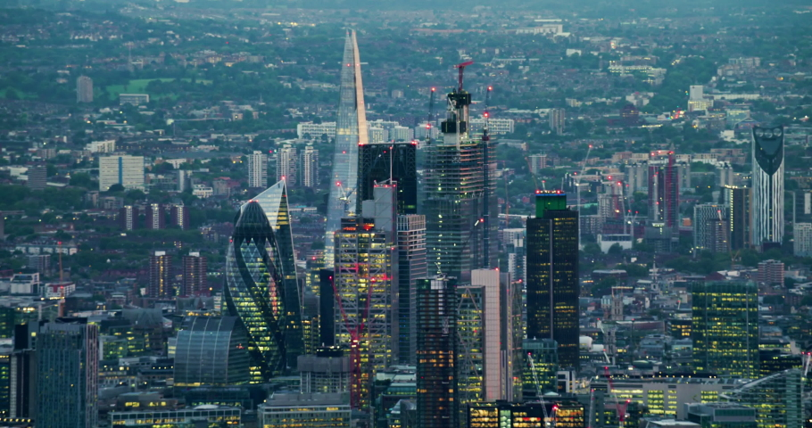 Aerial view of London's financial district skyscrapers. The city famous buildings. This is one of the financial centers of London. Cityscape at dawn. England. UK. | Shutterstock HD Video #1040869232