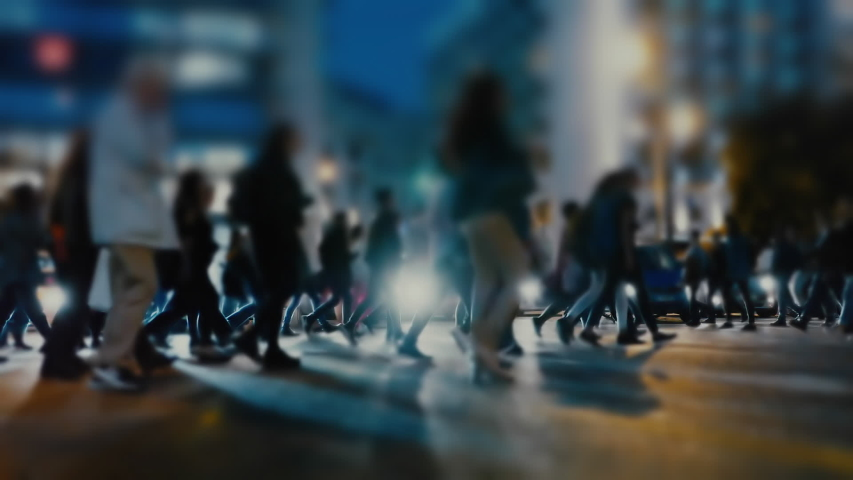 People and shoppers cross a busy city street.People and traffic in a busy European city at night. #1041061742