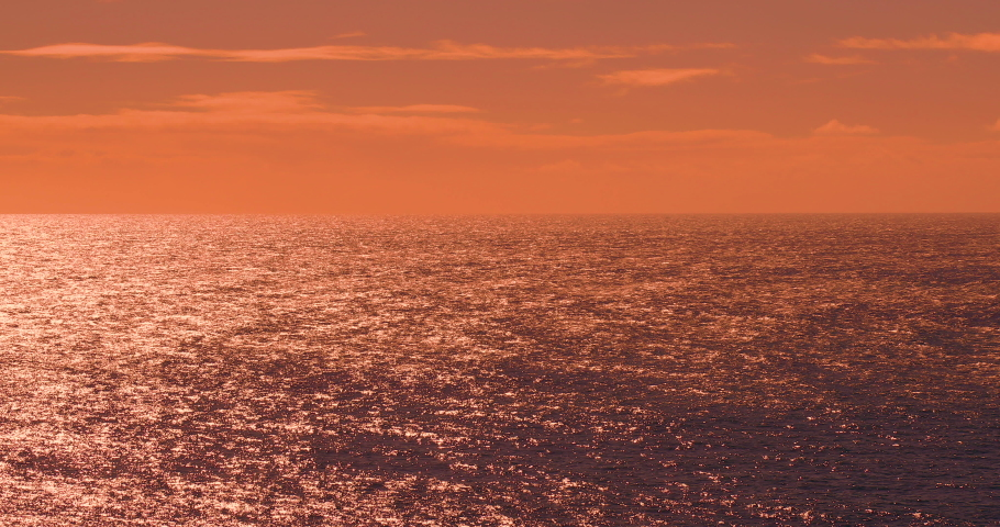 Summer travel sunset sunlight. Orange sky over ocean. Evening horizon nature landscape. Beautiful coast water sunrise. Beach shore tourism vacation. Seascape dawn sea reflection. Coastline background. | Shutterstock HD Video #1041073352