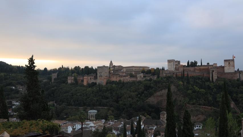Morning sky scene at Ancient arabic fortress Alhambra, Granada, Spain, European travel landmark | Shutterstock HD Video #1041080482