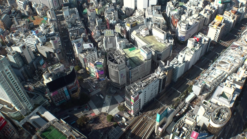 SHIBUYA, TOKYO, JAPAN - NOVEMBER 2019 : Aerial high angle top view around SHIBUYA scramble crossing in day time. Busy crowded downtown area in Tokyo. Japanese business and city lifestyle concept. #1041091492