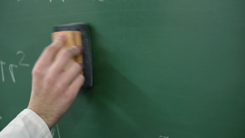 Teacher cleaning the chalkboard with maths equations .  | Shutterstock HD Video #1041292042