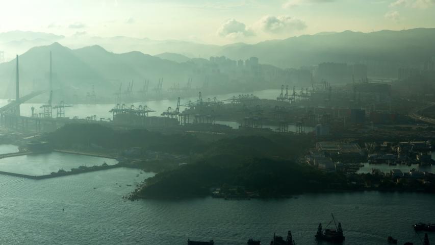 Hong Kong container port terminal and logistics center timelapse pan up | Shutterstock HD Video #1041461752