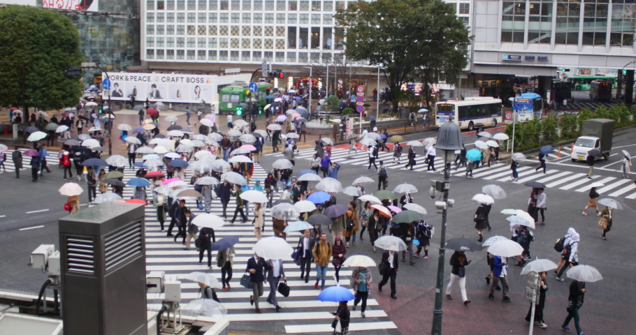 Tokyo, Japan. Circa October 2019: People walking in Shibuya Crossing, Tokyo, Japan. Rain, season, monsoon, crowded, crowd, crosswalk #1041499672