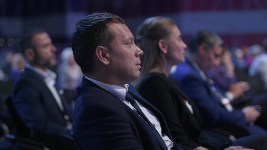 Meeting at Economic Conference or Political Briefing. Speaker Speech at Occupation of Busy Caucasian People. Information for Success or Sale Idea. Attractive Business Man and Row of Seats at Congress | Shutterstock HD Video #1041720442