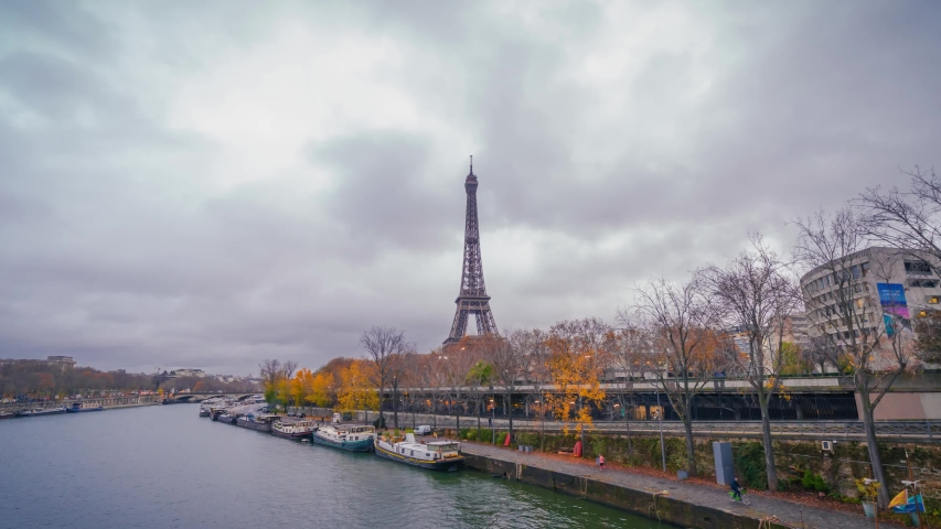 Hyperlapse (timelapse in motion) of the Eiffel tower from Bir-Hakeim bridge, over the river Seine , Paris, France, at a cloudy autumn day | Shutterstock HD Video #1041904102