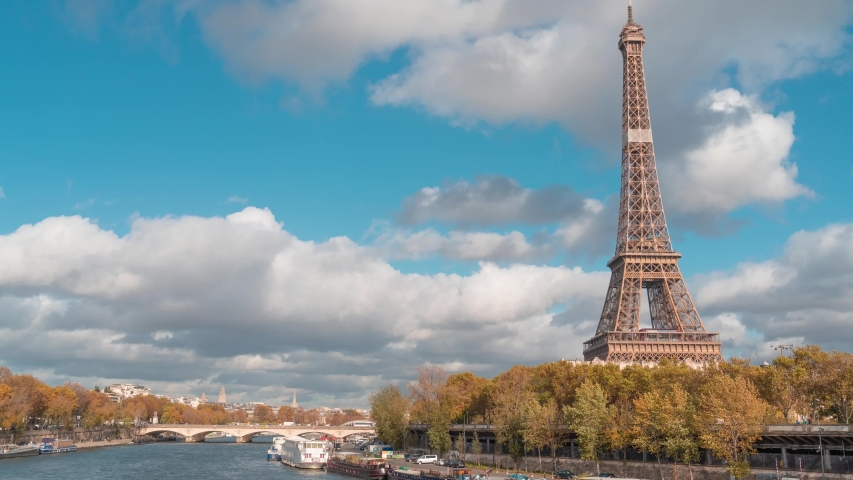 Timelapse of the Eiffel tower  from Bir-Hakeim bridge, over the river Seine , Paris, France, at a cloudy but sunny autumn day | Shutterstock HD Video #1041999862