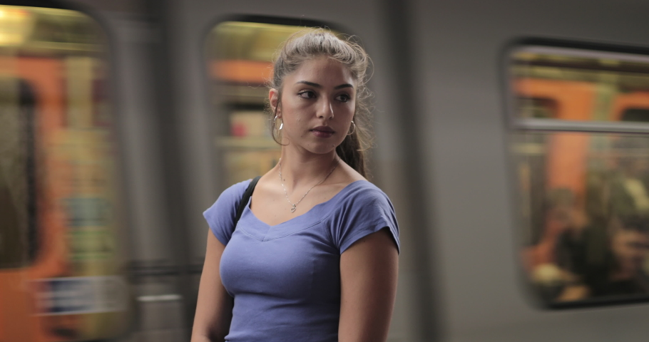 Hispanic female waiting for train at subway station | Shutterstock HD Video #1042200652