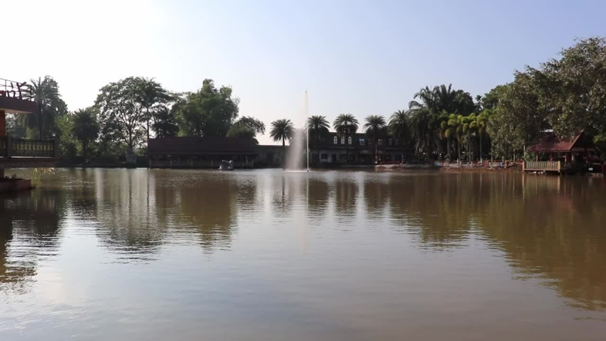 [object Object]Fountain in the middle of the marshes in the park Attractions | Shutterstock HD Video #1042209442