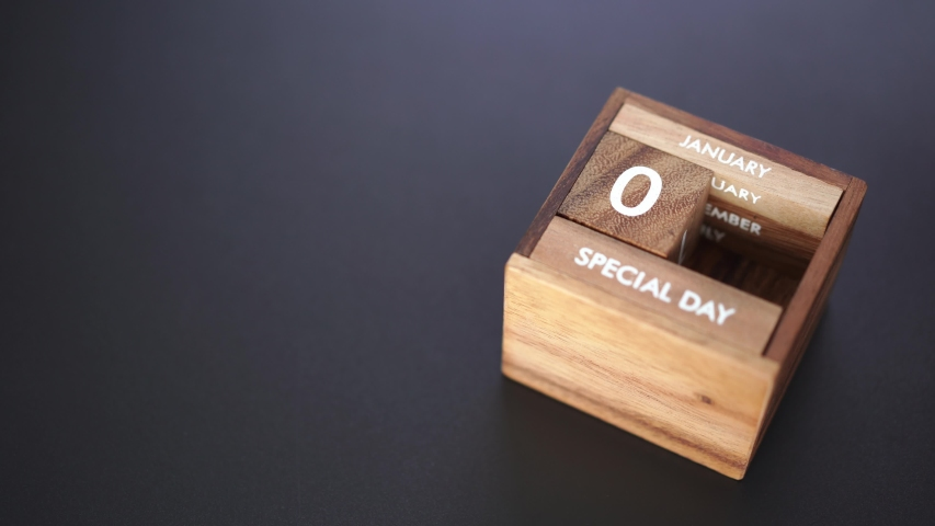 Day and month of special day of year fill into wooden cube calendar, copy space on left | Shutterstock HD Video #1042247932