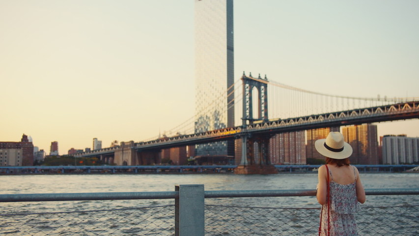 Young tourist at the Manhattan bridge in summer | Shutterstock HD Video #1042252882